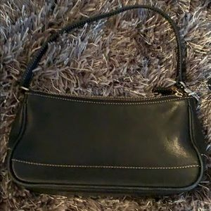 Coach - Small black leather hand bag.